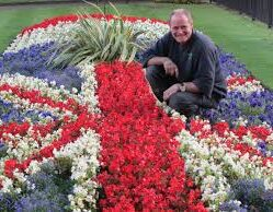 Steve Thorpe stood in flowerbed in Town Hall Square